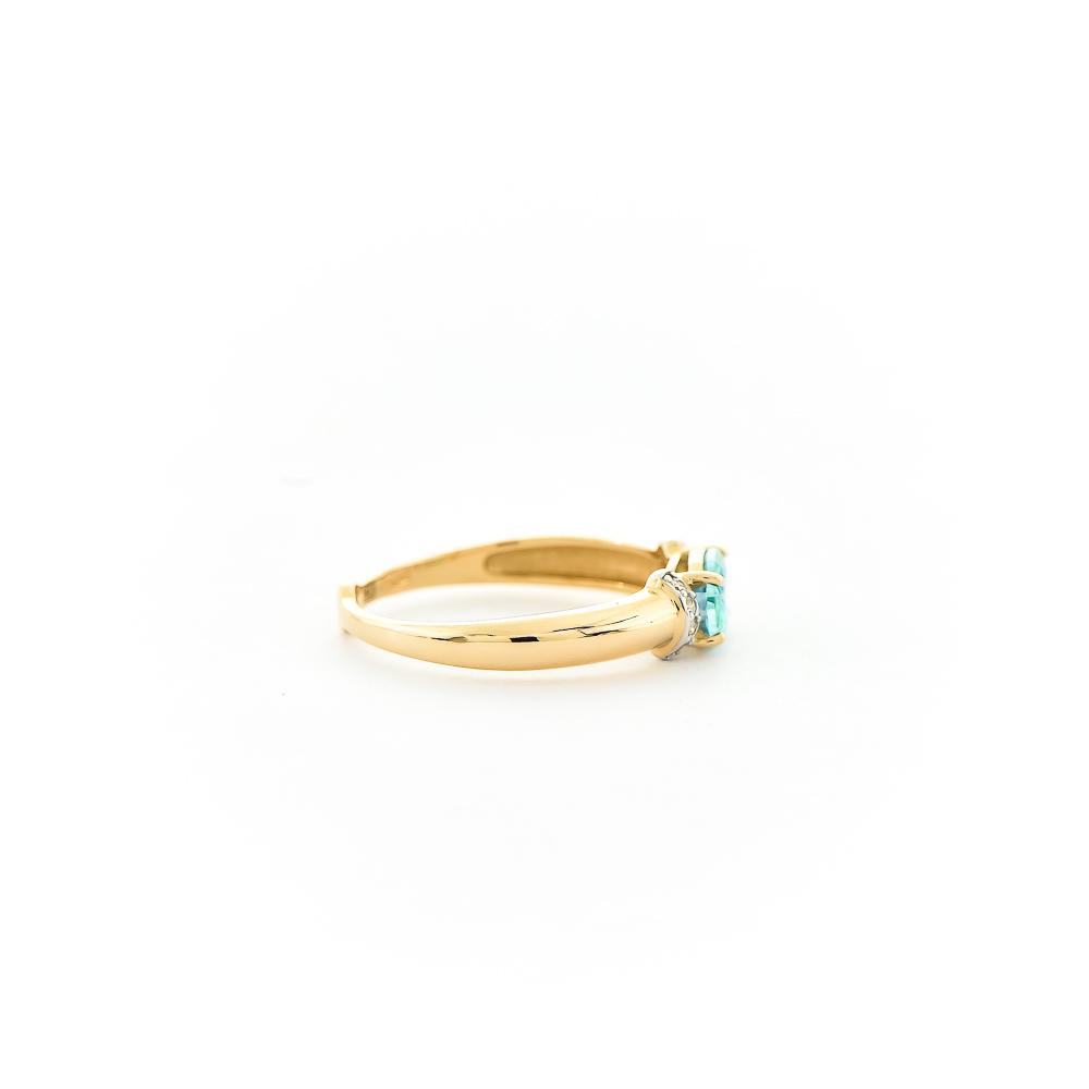 Кольцо из золота с бесцветными и зелёным Swarovski Zirconia
