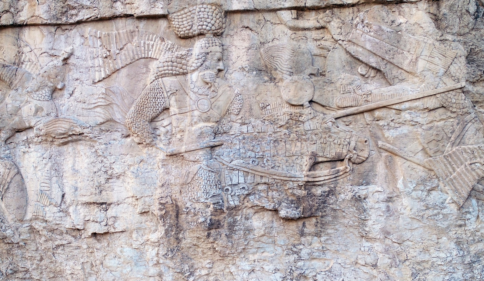 Figure 1. Tang-e Ab (Southern Central Fars, Iran): Firuzabad I rock relief: first combat on the right. (Source: photo P. Callieri, elaboration A. Eghra').